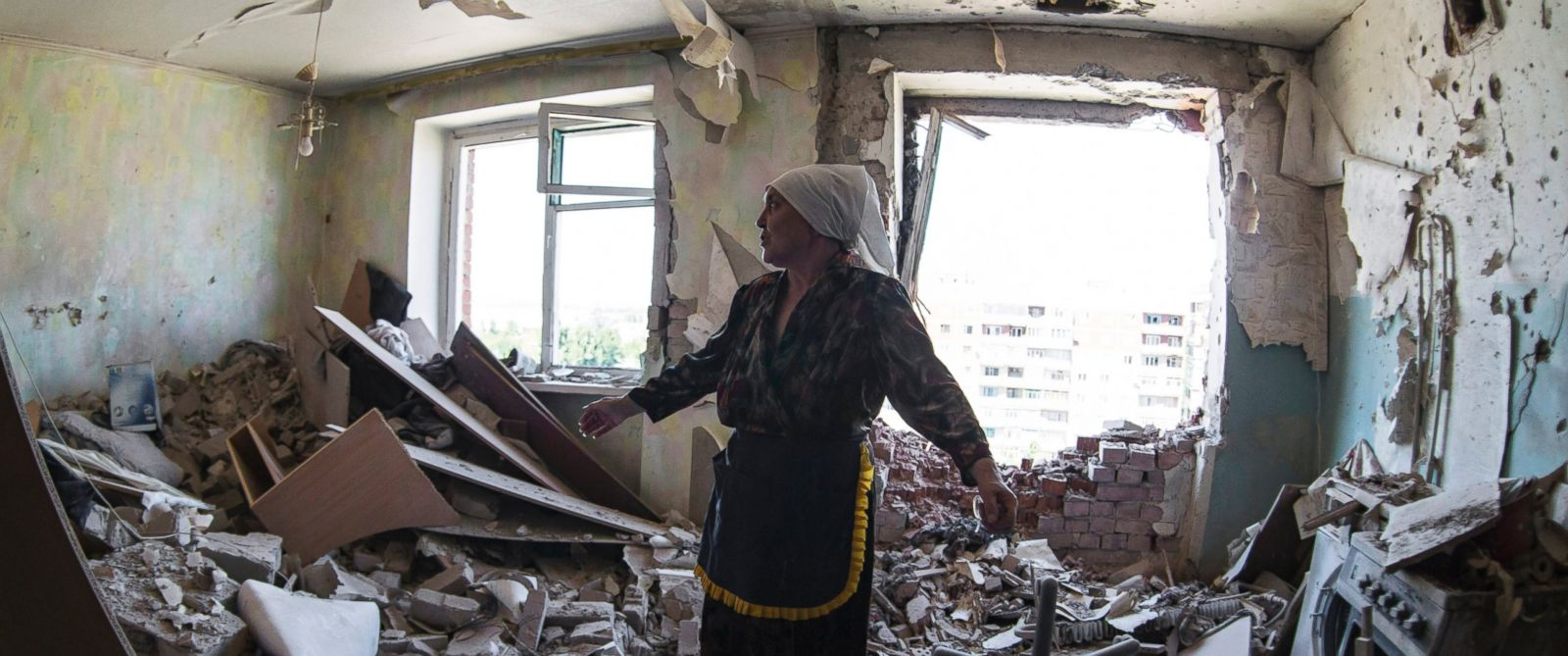 PHOTO: Valentina, who gave only her first name, gestures in a flat of her neighbor who was injured during shelling in the city of Kramatorsk, Donetsk region, eastern Ukraine, Thursday, July 3, 2014.