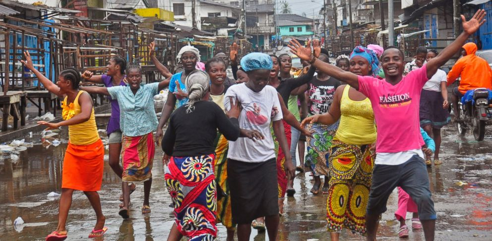 People celebrate on the streets outside of West Point, which has been closed in by Liberian security forces to stop all movement the past week in a attempt to control the Ebola outbreak in Monrovia, Liberia, Saturday, Aug. 30, 2014.