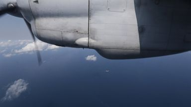 PHOTO: Ships are seen from a flying Soviet-made AN-26 of the Vietnam Air Force during a search operation for the missing Malaysia Airlines Boeing 777 over the South China Sea Monday, March 10, 2014.