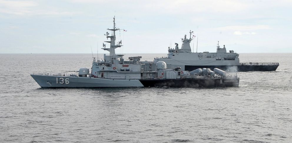 PHOTO:  Royal Malaysian Navy vessels are seen during a search and rescue operation for the missing Malaysia Airlines plane over the Straits of Malacca, Malaysia, Thursday, March 13, 2014.