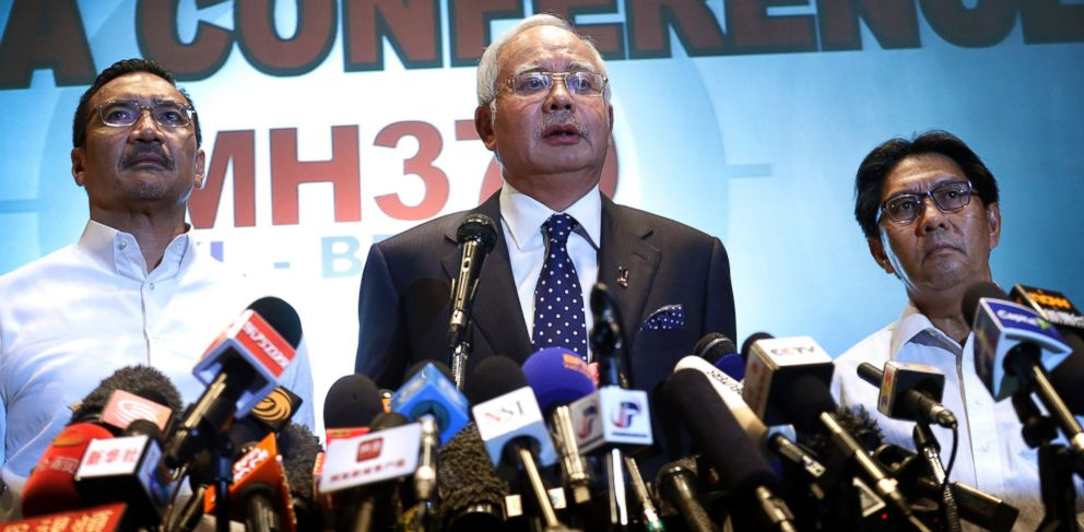 PHOTO: Malaysian Prime Minister Najib Razak, center, delivers a statement to the media regarding missing Malaysia Airlines jetliner MH370, Saturday, March 15, 2014 in Sepang, Malaysia.