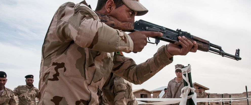 PHOTO: In this photo an Iraqi army trainee rehearses proper room clearing techniques under the supervision of a U.S. Marine during training,