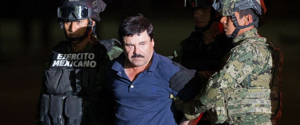 """PHOTO: Joaquin """"El Chapo"""" Guzman is made to face the press as he is escorted to a helicopter in handcuffs by Mexican soldiers and marines at a federal hangar in Mexico City, Mexico, Friday, Jan. 8, 2016."""