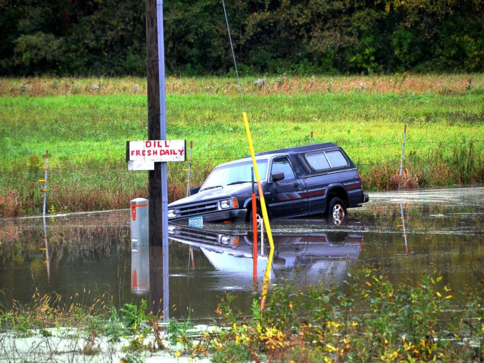 PHOTO: A pick-up truck is partially submerged in Faribault, Minnesota, Sept. 22, 2016, after heavy rain in the state.
