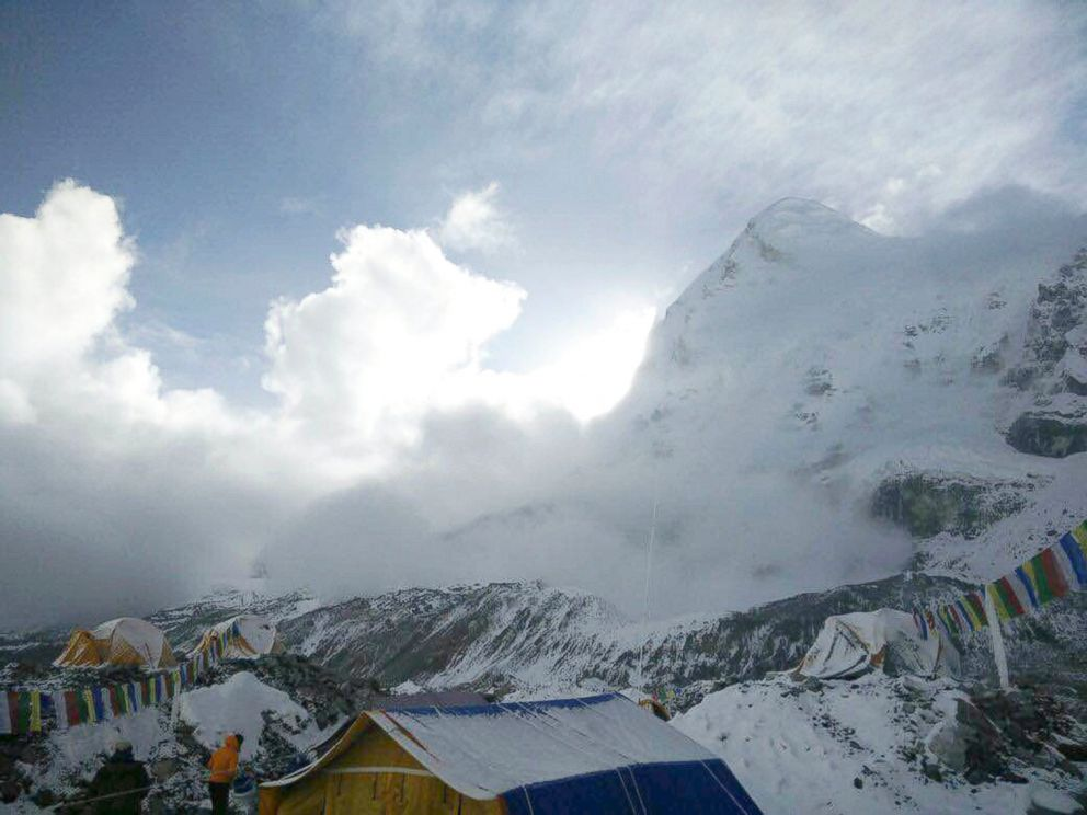 This photo provided by Azim Afif, shows a small avalanche on Pumori mountain as seen from Everest Base Camp, Nepal on Sunday, April 26, 2015.