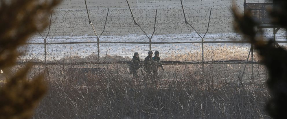 PHOTO: South Korean Army soldiers patrol along the barbed-wire fence in Paju, near the border with North Korea, South Korea, Sunday, Feb. 7, 2016.