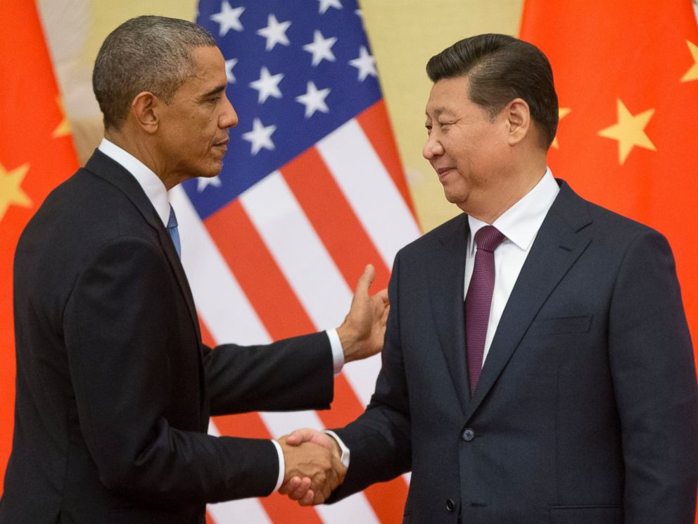 U.S. President Barack Obama, left, and Chinese President Xi Jinping shake hands following the conclusion of their joint news conference at the Great Hall of the People in Beijing, Nov. 12, 2014.