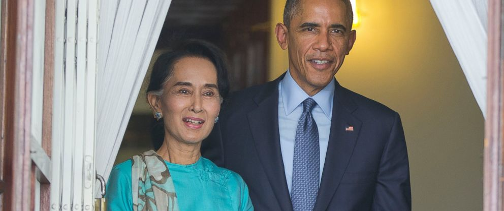 U.S. President Barack Obama, right, walks out with Myanmars opposition leader Aung San Suu Kyi at her home before the start of their joint news conference in Yangon, Myanmar, Nov. 14, 2014.