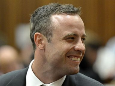 Photos: Tense Start to Oscar Pistorius Murder Trial