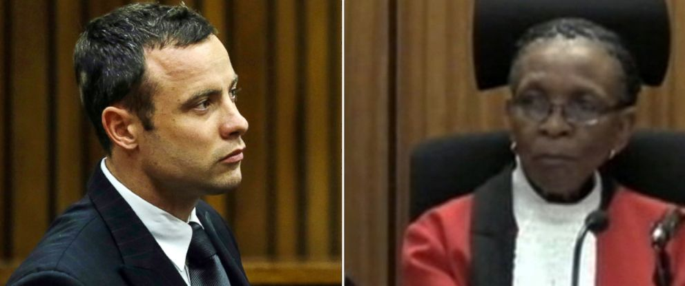 PHOTO: Oscar Pistorius, left and Judge Thokozile Masipais, right are seen in court during the murder trial of Reeva Steenkamp, in Pretoria, South Africa, March 11, 2014.