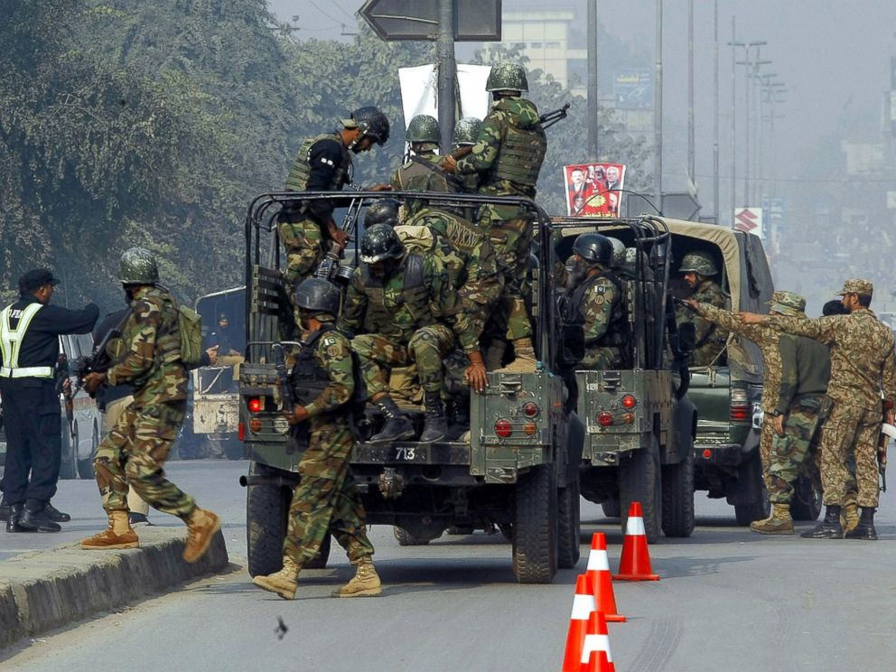 PHOTO: Pakistani army troops arrive to conduct an operation at a school under attack by Taliban gunmen in Peshawar, Pakistan, Dec. 16, 2014.