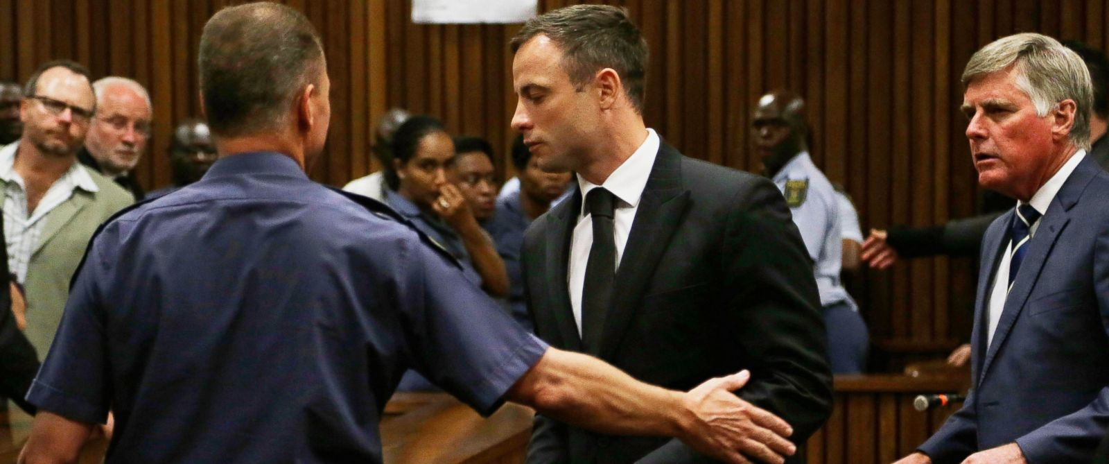PHOTO: Oscar Pistorius, center, is led out of court in Pretoria, South Africa, Oct. 21, 2014.
