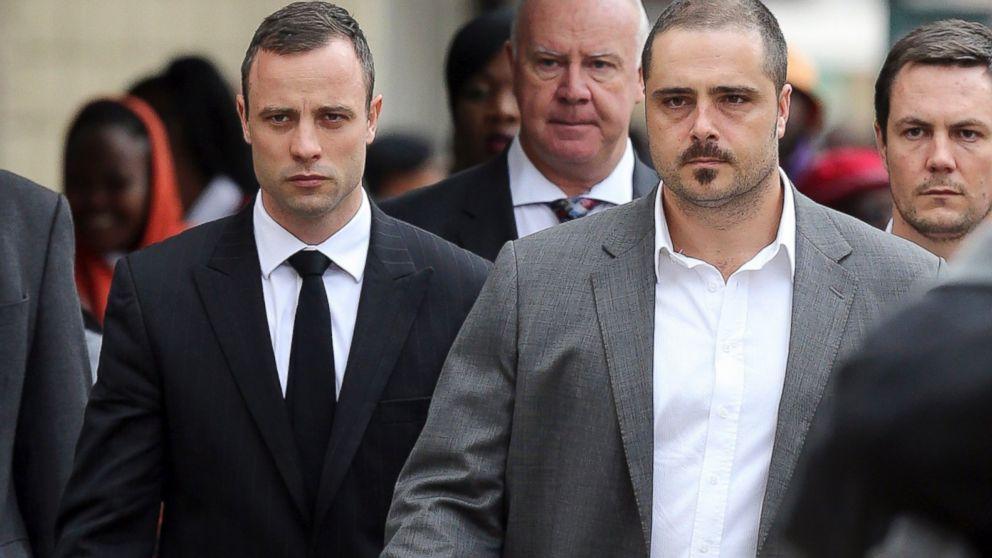 PHOTO: Oscar Pistorius walks to the high court in Pretoria, South Africa, April 9, 2014.