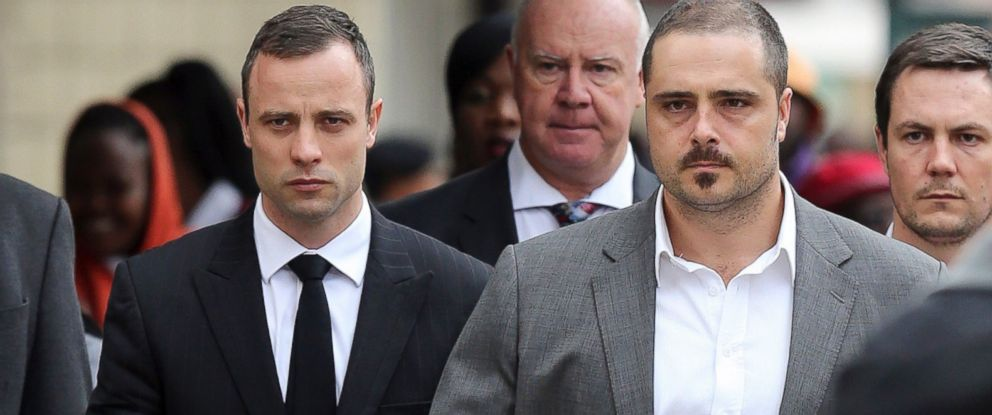PHOTO: Oscar Pistorius walks to the high court in Pretoria, South Africa, April 9, 2014.