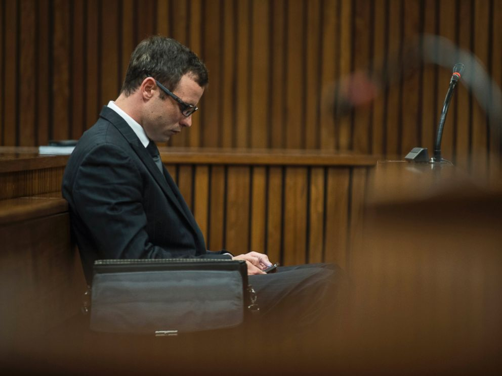 Oscar Pistorius appears in a courtroom at his murder trial in Pretoria, South Africa, Thursday, Aug. 7 2014.