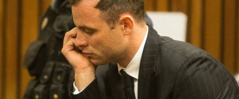 PHOTO: Oscar Pistorius, foreground, in court, Oct. 13, 2014. Pistorius faces sentencing this week in a South African court after being convicted of culpable homicide for killing girlfriend Reeva Steenkamp.