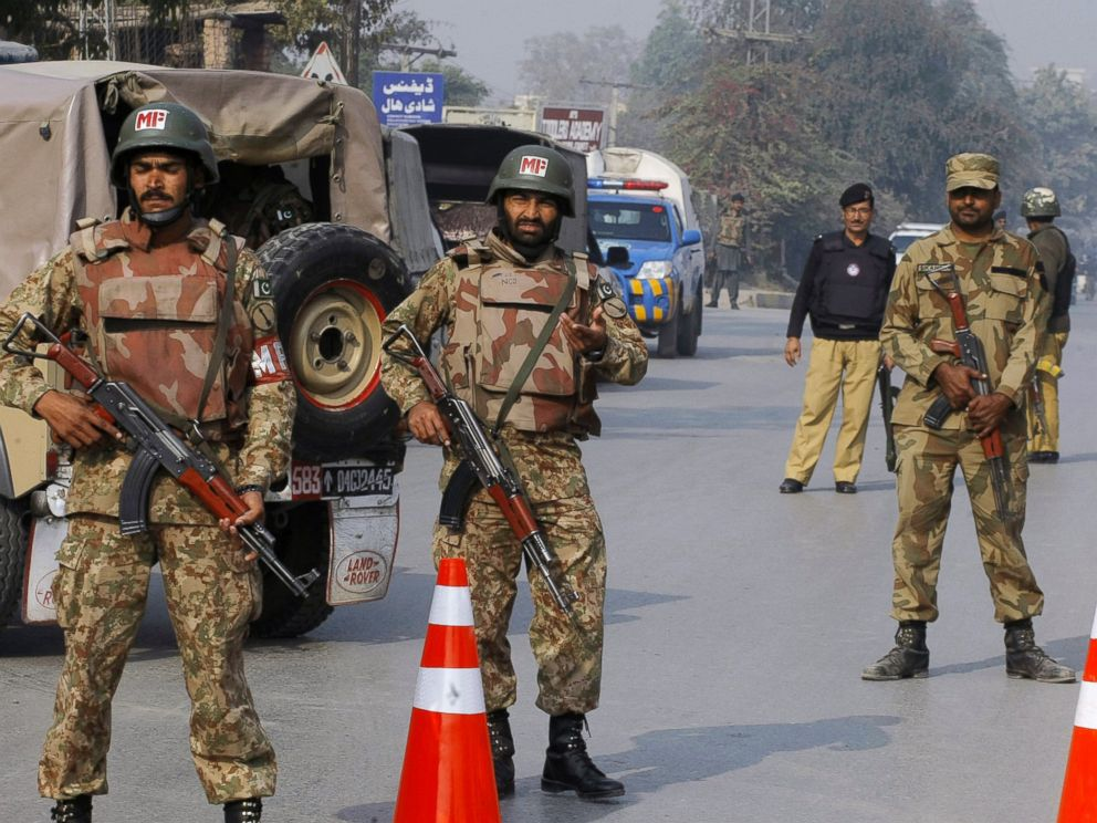 PHOTO: Pakistani army troops cordon off a road leading to a school under attack by Taliban gunmen in Peshawar, Pakistan, Dec. 16, 2014.