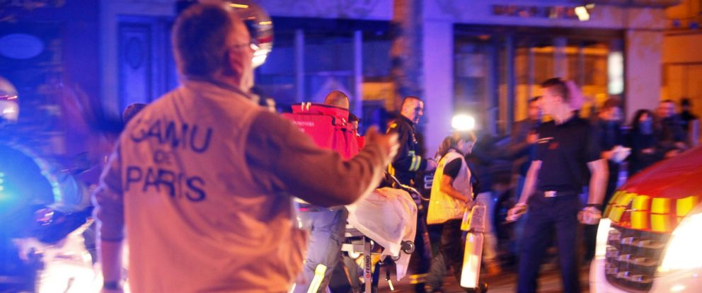 PHOTO: Person are being evacuated after a shooting, outside the Bataclan theater in Paris, Saturday, Nov. 14, 2015.