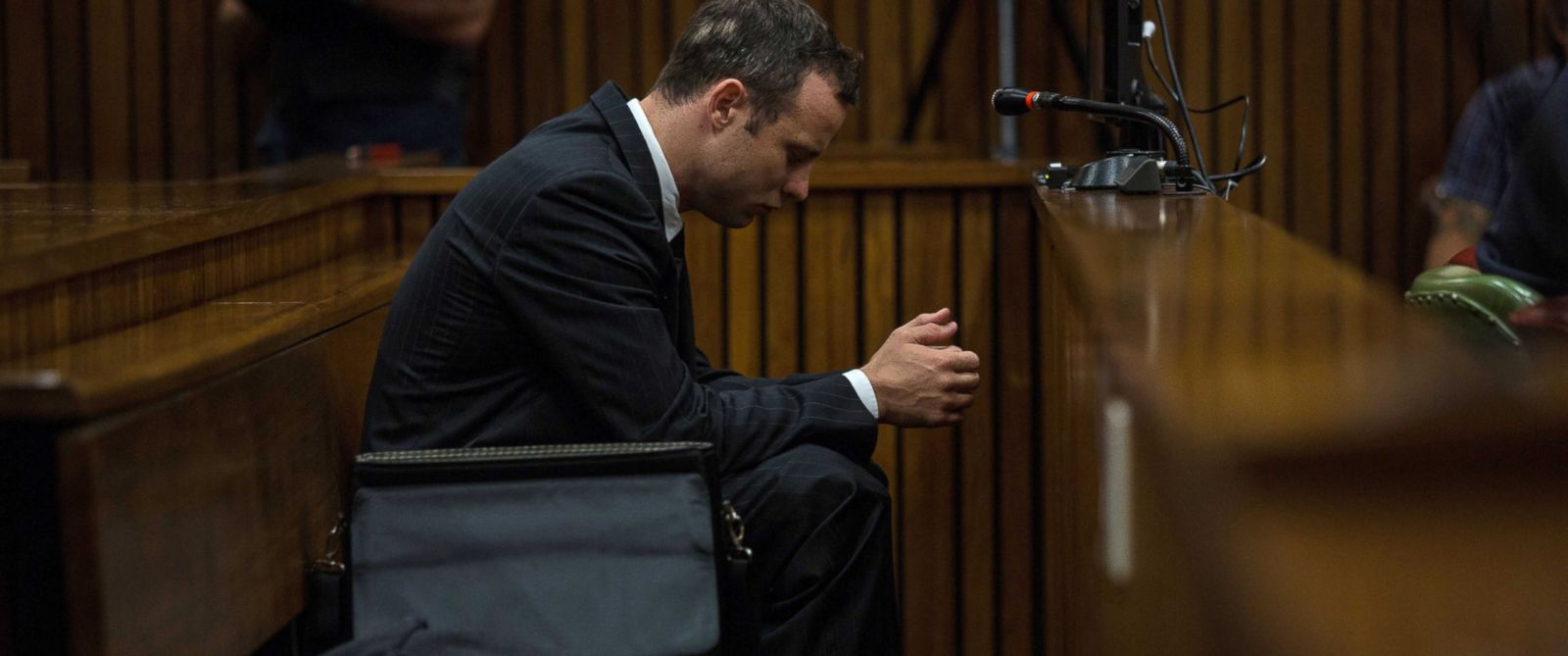 PHOTO: Oscar Pistorius sits in the dock as he listens to cross questioning about the events surrounding the 2013 shooting death of his girlfriend Reeva Steenkamp in Pretoria, South Africa, Tuesday, March 11, 2014.