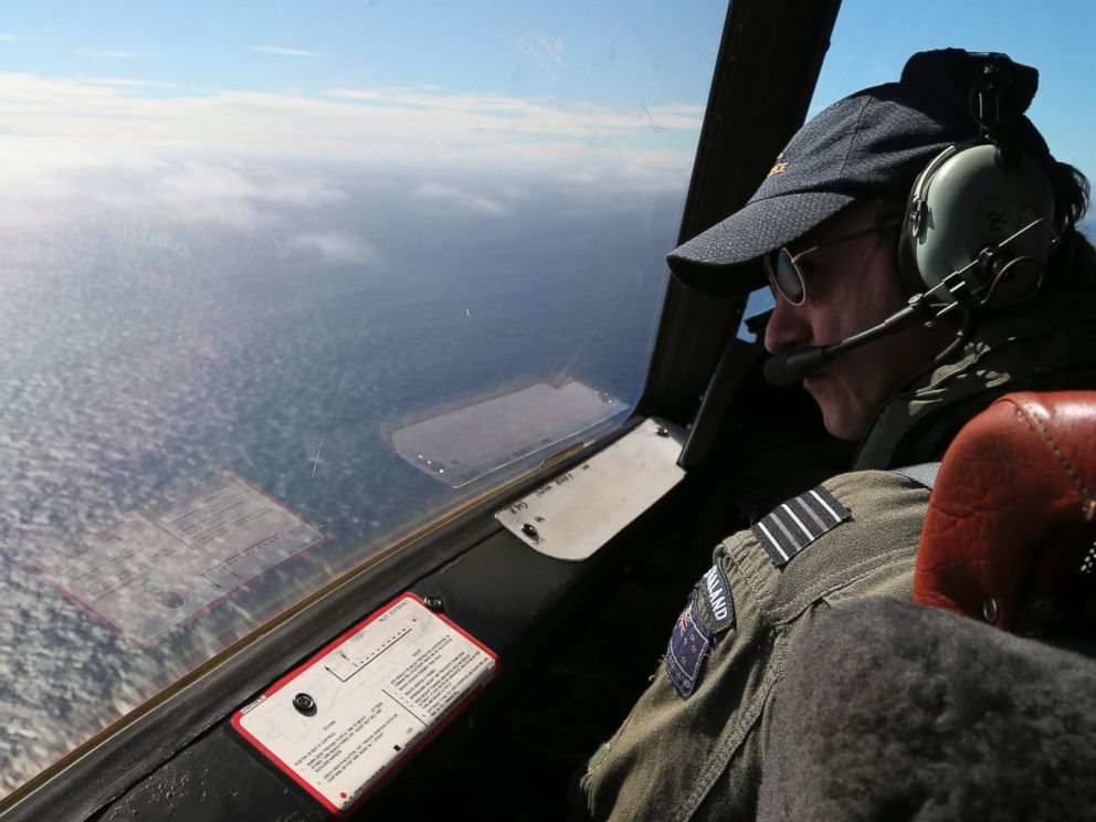 PHOTO: Royal New Zealand Air Force P-3 Orions captain, Wing Comdr. Rob Shearer watches out of the window of his aircraft while searching for the missing Malaysia Airlines Flight MH370 in the southern Indian Ocean, Monday, March 31, 2014.