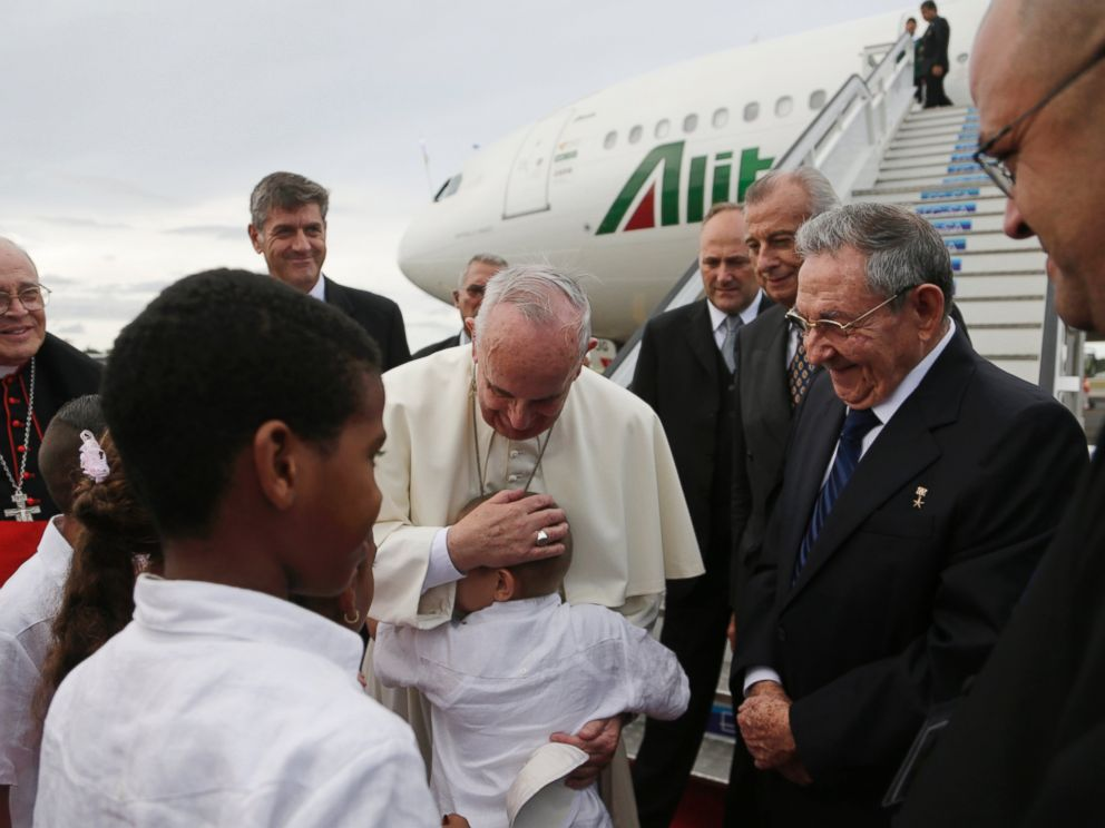 PHOTO: Pope Francis hugs a boy as Cubas President Raul Castro looks on after landing at the airport in Havana, Cuba, Saturday, Sept. 19, 2015.