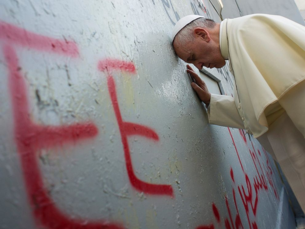 PHOTO: Pope Francis touches the wall that divides Israel from the West Bank, on his way to celebrate a mass in Manger Square next to the Church of the Nativity in the West Bank town of Bethlehem, Sunday, May 25, 2014.