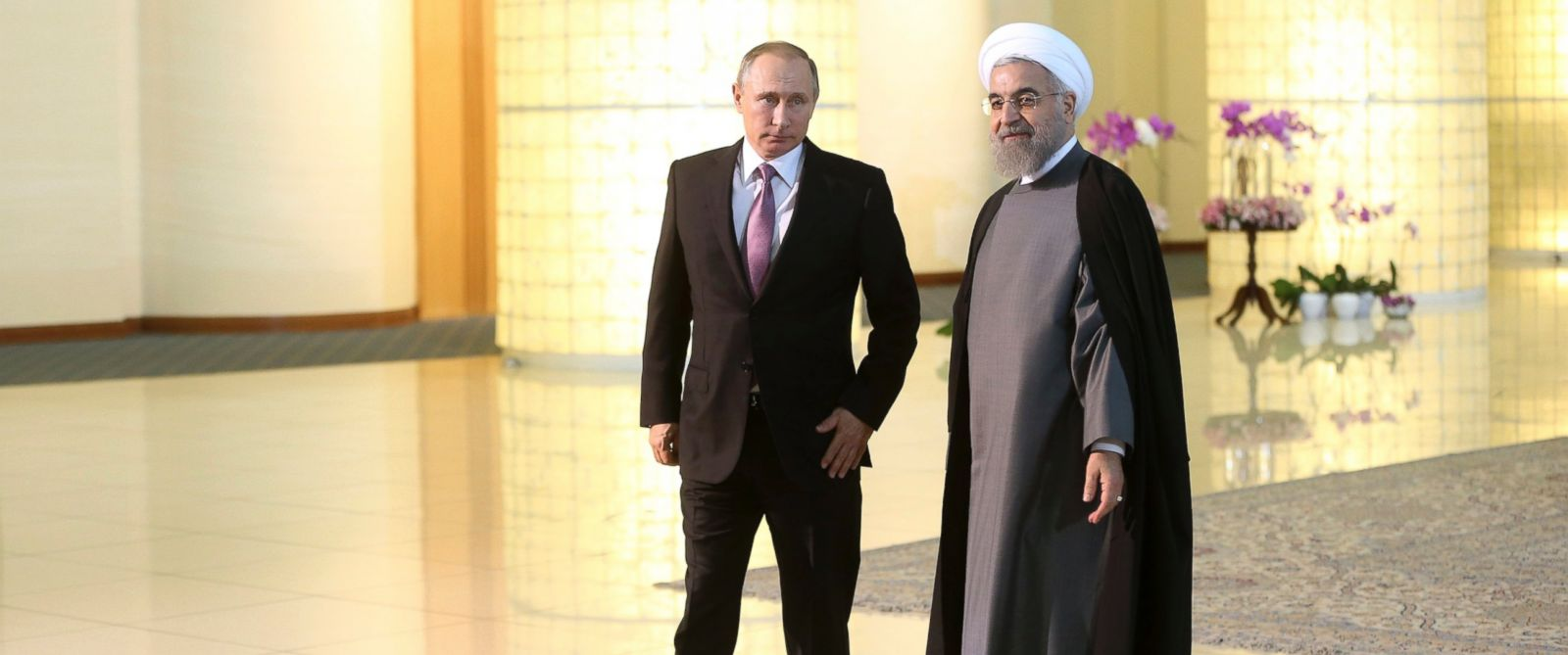 PHOTO: Russian President Vladimir Putin, left, and his Iranian counterpart Hassan Rouhani arrive for the Gas Exporting Countries Forum, GECF, summit meeting in Tehran, Iran, Nov. 23, 2015.