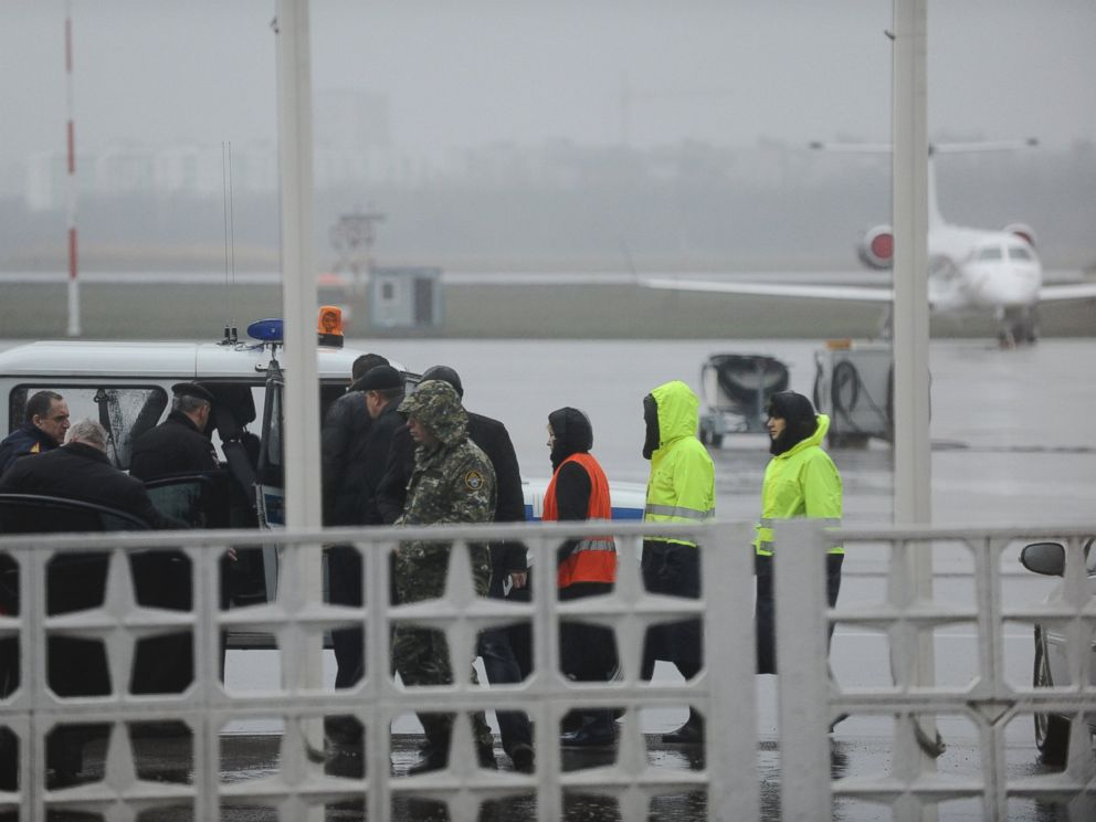 PHOTO: Russian Emergency Situations Ministry employees and police officers are seen as they take a car to drive to the area of the FlyDubai flight 981 crash site at the Rostov-on-Don airport on Saturday, March 19, 2016.