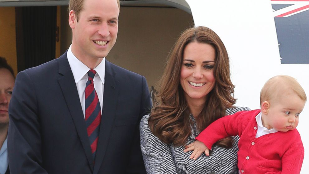 PHOTO: Britains Prince William, left, and Kate, the Duchess of Cambridge, center, along with son Prince George, stand atop of the stairs to say goodbye as they board their flight in Canberra, Australia, April 25, 2014.