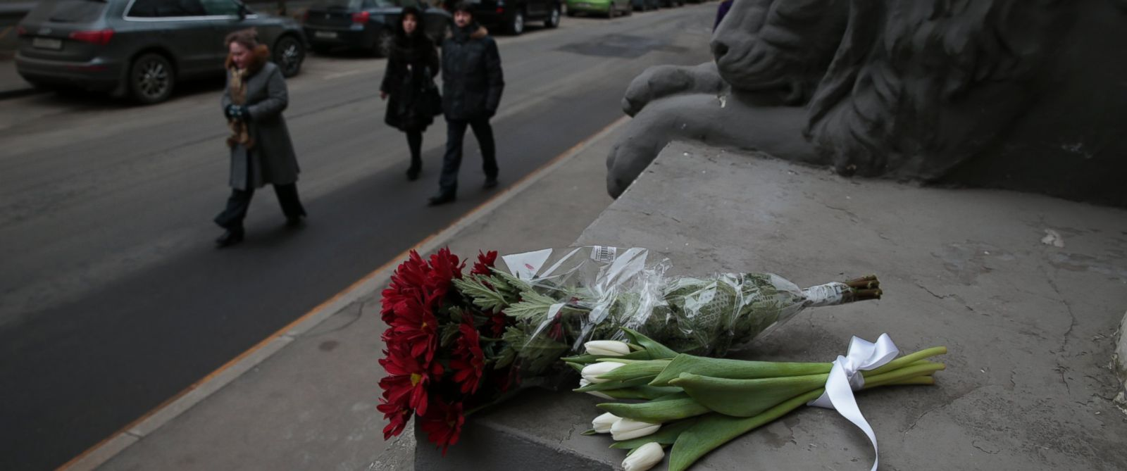 PHOTO: Flowers are placed outside the embassy of Belgium, in Moscow, March 22, 2016.
