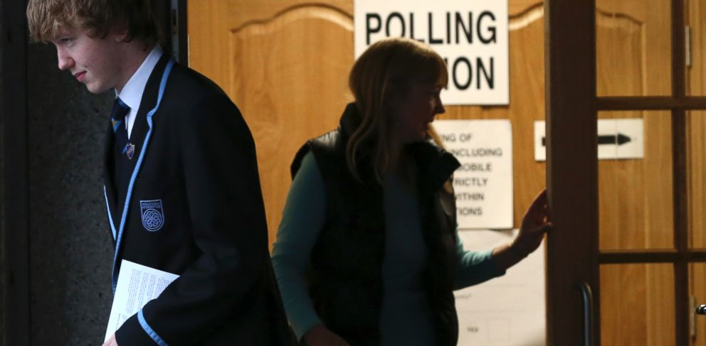 PHOTO: Voters leave after casting their ballots at Ritchie Hall in Strichen, Scotland, Sept. 18, 2014.