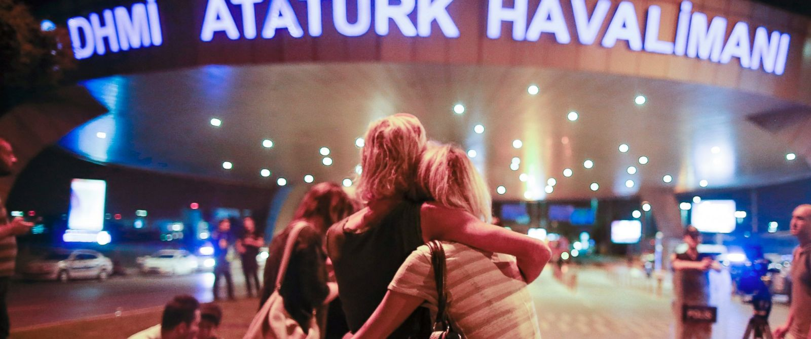 PHOTO: Passengers embrace each other at the entrance to Istanbuls Ataturk airport, early Wednesday, June 29, 2016 following their evacuation after a blast.