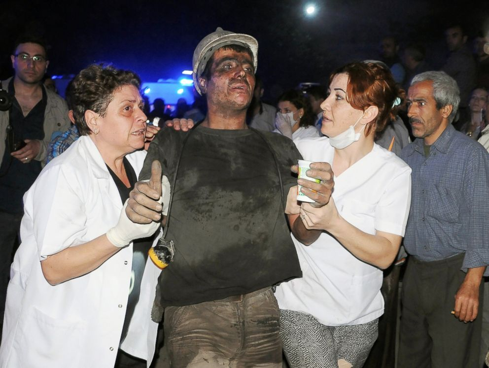 PHOTO: Medics help a rescued miner after an explosion and fire at a coal mine in Soma, western Turkey, May 13, 2014.