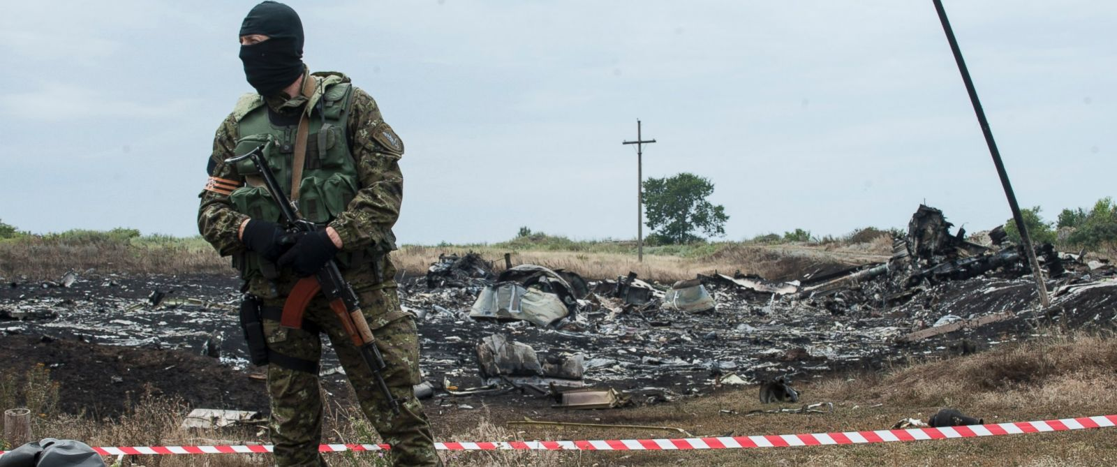 PHOTO: A pro-Russian fighter guards the crash site of a Malaysia Airlines jet near the village of Hrabove, eastern Ukraine, Saturday, July 19, 2014.