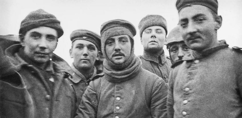 In this image provided by the Imperial War Museum, World War I German and British soldiers stand together on the battlefield near Ploegsteert, Belgium during Dec. 1914.
