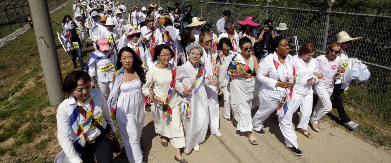 PHOTO: Gloria Steinem, Mairead Maguire, Leymah Gbowee, and other activists march to the Imjingak Pavilion with South Korean activists along the military wire fences near the border village of Panmunjom, in Paju, north of Seoul, South Korea, May 24, 2015.