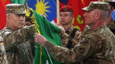 PHOTO: Commander of the International Security Assistance Force (ISAF), Gen. John Campbell, left, and Command Sgt. Maj. Delbert Byers open the Resolute Support flag during a ceremony at the ISAF headquarters in Kabul, Afghanistan, Dec. 28, 2014.