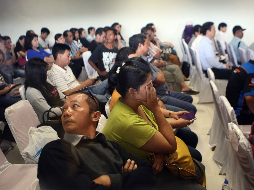 PHOTO: Relatives and next-of-kin of passengers on the AirAsia flight QZ8501 wait for the latest news