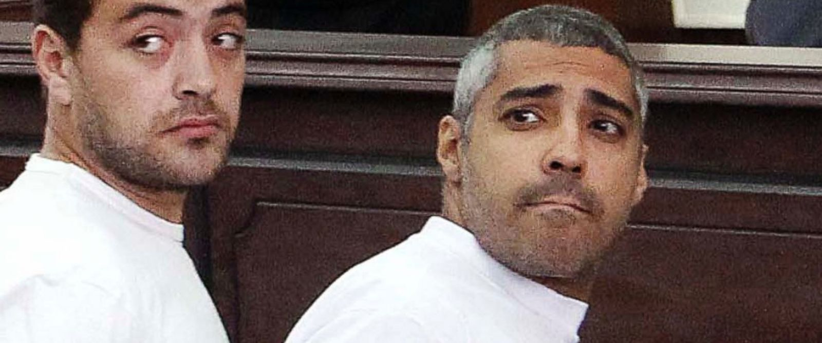 PHOTO: In this March 31, 2014 file photo, Baher Mohamed, left, and Mohammed Fahmy, right, appear in court along with several other defendants during their trial on terror charges, in Cairo.