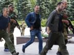 PHOTO: Alexander Borodai, Prime Minister of the self proclaimed Donetsk Peoples Republic, center, walks accompanied by pro-Russian fighters in Donetsk, eastern Ukraine, July 20, 2014.