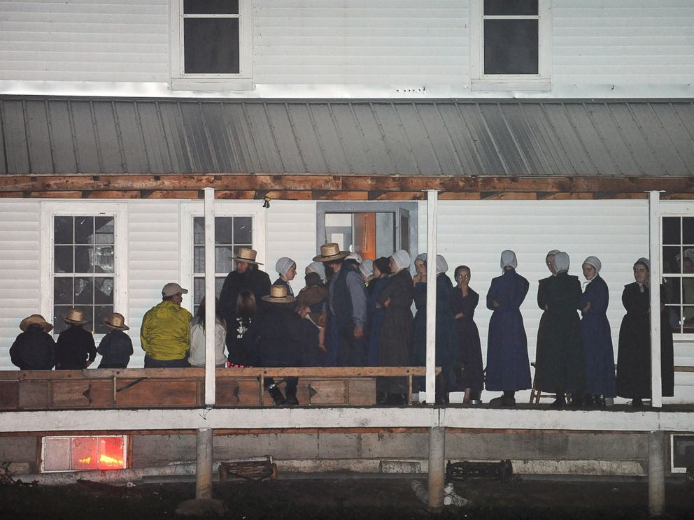 PHOTO: Supporters gather on the porch of a house at the intersection of Route 812 and Mt. Alone Road