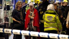 PHOTO:A woman stands bandaged and wearing a blanket given by emergency services following an incident at the Apollo Theatre, Dec. 19, 2013, with police saying there were