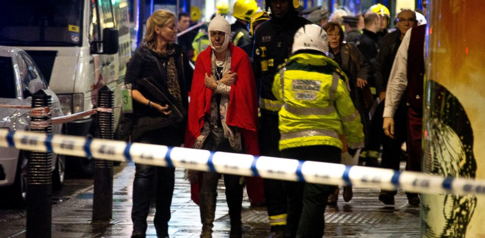 "PHOTO:A woman stands bandaged and wearing a blanket given by emergency services following an incident at the Apollo Theatre, Dec. 19, 2013, with police saying there were ""a number"" of casualties."