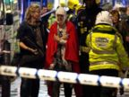 PHOTO:A woman stands bandaged and wearing a blanket given by emergency services following an incident at the Apollo Theatre, Dec. 19, 2013, with police saying there were a number of casualties.
