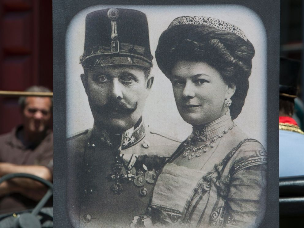 PHOTO: Tourists look at exhibits in Sarajevo museum, including portraits of Archduke Franz Ferdinand and Sofia von Hochenberg, in Sarejevo, Saturday, June 28, 2014.