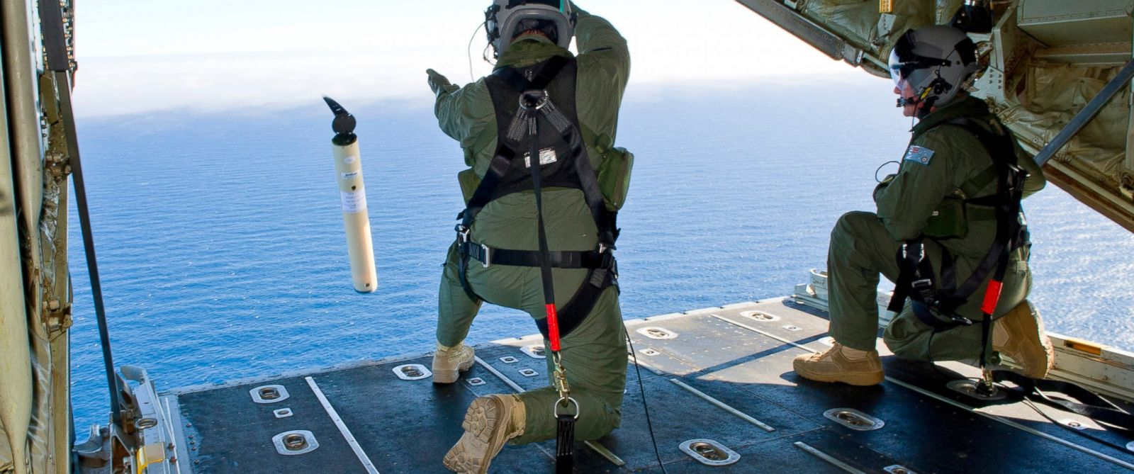 PHOTO: Members of the Royal Australian Air Force launch a Self Locating Data Marker Buoy from a C-130J Hercules aircraft in the southern Indian Ocean as part of the Australian Defense Forces assistance to the search for Malaysia Airlines flight MH370.