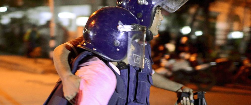 PHOTO: Security personnel is taken for medical attention after a group of gunmen attacked a restaurant popular with foreigners in a diplomatic zone of the Bangladeshi capital Dhaka, Bangladesh, July 1, 2016.