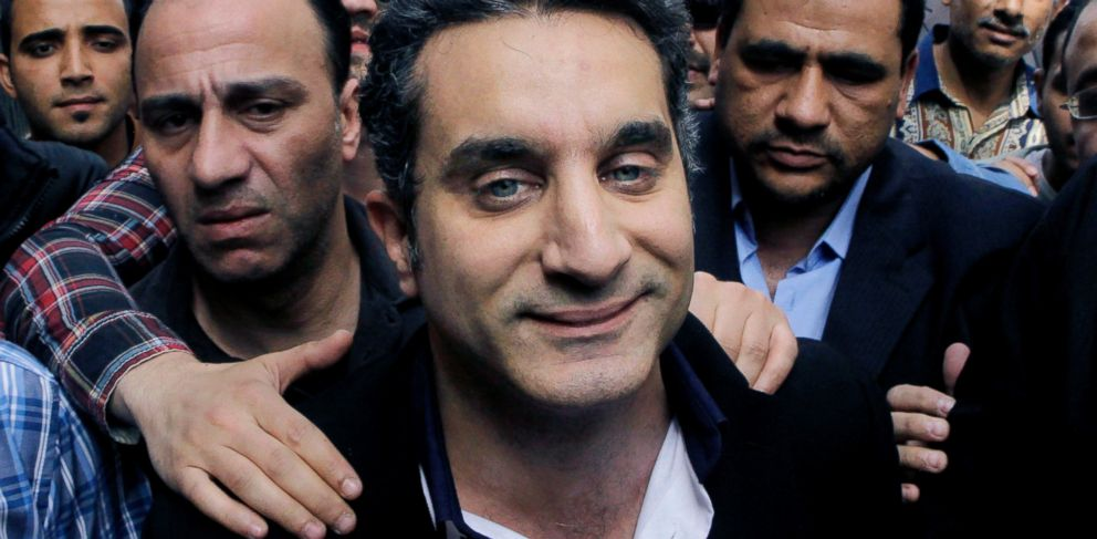 PHOTO: Popular Egyptian television satirist Bassem Youssef enters Egypts state prosecutors office to face accusations of insulting Islam and the countrys Islamist leader in Cairo, Egypt, March 31, 2013.