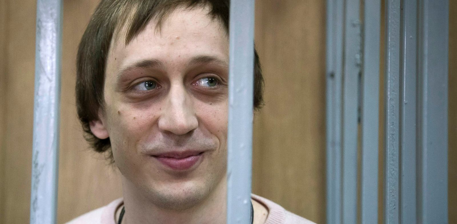 PHOTO: Pavel Dmitrichenko stands inside a barred enclosure at a courtroom in Moscow, Russia