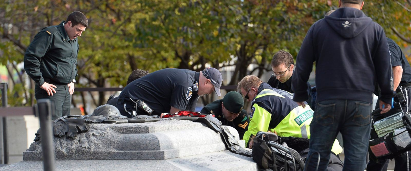PHOTO: Emergency personnel tend to a soldier shot at the National Memorial near Parliament Hill in Ottawa, Oct. 22, 2014.